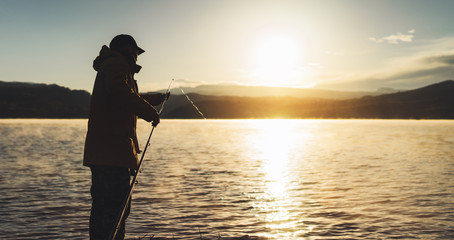outline fisherman fishing rod at sunrise sunlight, man enjoy hobby on evening lake, person catch fish on background night sky, relaxation vacation fishery concept