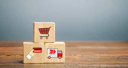 Wooden blocks with online shopping symbols. Shopping cart, card for payment, delivery truck. Seller over the Internet. Ecommerce and delivery service concept