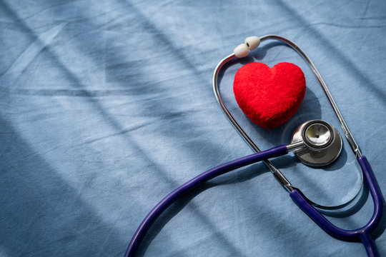 Medical stethoscope and red heart with cardiogram.Concept healthcare.