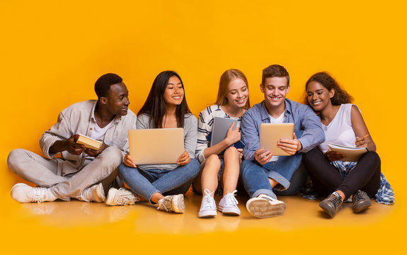 Group of international students studying for university exams