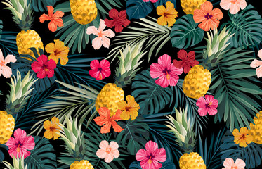 Seamless hand drawn tropical vector pattern with exotic palm leaves, hibiscus flowers, pineapples and various plants on dark background. Wall mural