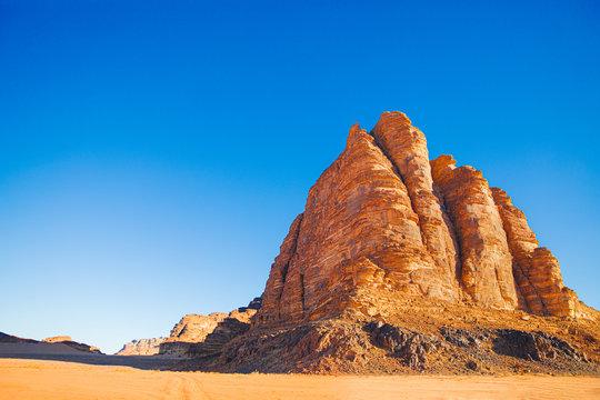 Sand mountain The Seven Pillars of Wisdom against the blue sky, Jordan, Wadi RAM desert.