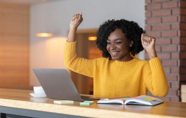 Black girl celebrating success, found good job