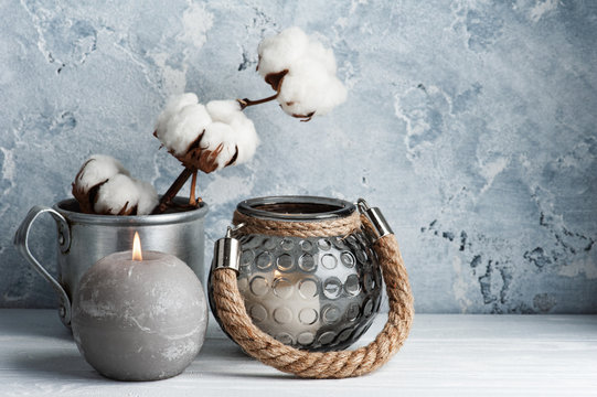 Scandinavian interior with cotton flowers and lit candles
