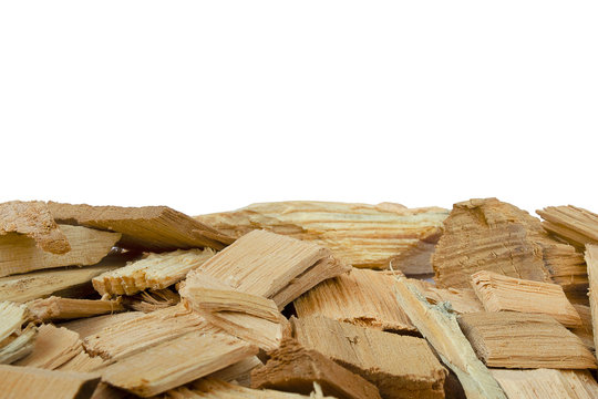 Light brown wood fuel chip isolated on white background with copy space. Wood chips with copy space. Oak wood chips. Parts of pine or oak wood chips on a white background.