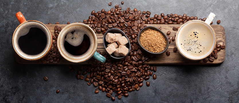 Coffee cup, sugar and roasted beans
