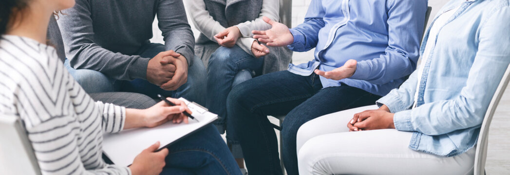 Trust circle. Group of unrecognizable people sitting together at therapy session