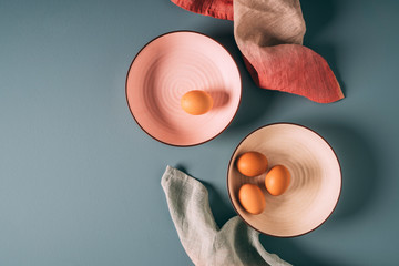 Overhead still life shot of farm fresh eggs on pastel plates with ombre napkins Fotobehang