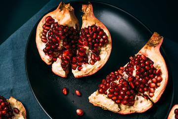 Fresh ripe pomegranate open on plate