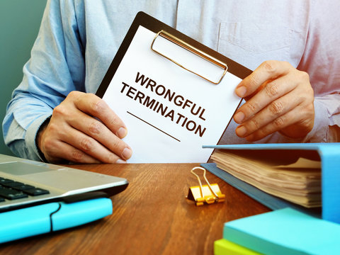 Employee holds papers about wrongful termination.