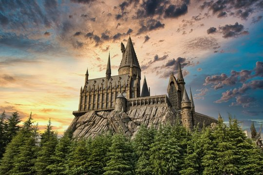 OSAKA, JAPAN - AUGUST 10, 2019:   Hogwarts Castle on sun set. The Wizarding World of Harry Potter in Universal Studios Japan. Universal Studios Japan (USJ) is a fun and famous theme park.