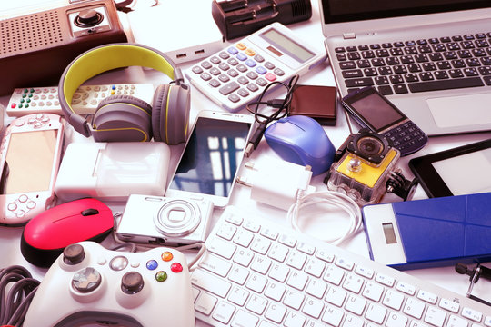 Many used modern Electronic gadgets for daily use on White floor, Reuse and Recycle concept