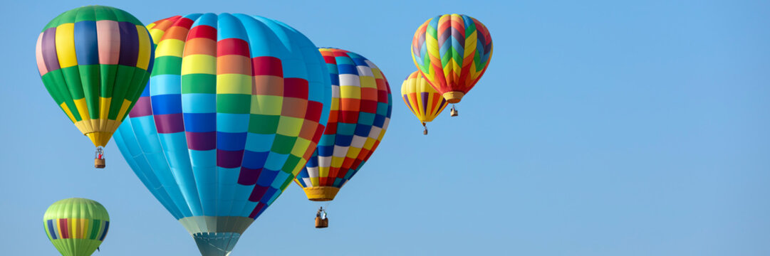 colorful hot air balloons in blue sky with copy space