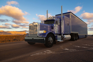 American Peterbilt truck with a semi-trailer driven on a desert road
