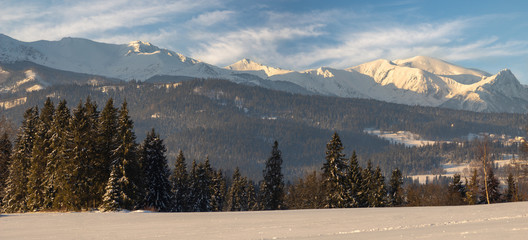Wall Mural - winter panorama of the mountains in the light of the rising sun - Tatra Mountains, Poland