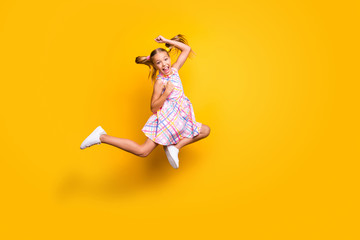 Keuken foto achterwand Wanddecoratie met eigen foto Full body photo cheerful crazy funky kid jump celebrate discount lottery victory raise fists scream yes wear plaid skirt isolated yellow bright color background