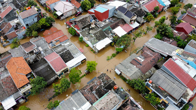Aerial POV view Depiction of flooding. devastation wrought after massive natural disasters at Bekasi - Indonesia