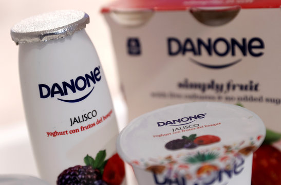 Company logos are seen on products displayed before French food group Danone 2019 annual results presentation in Paris