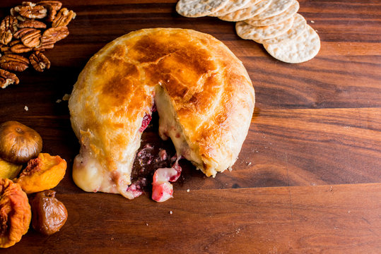 Baked Brie with cranberry chutney. Classic traditional party favorite.