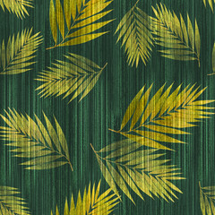Yellow tropical palm leaves pattern on a watercolor background