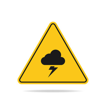 The triangular warning sign of a thunderstorm threat with lightning and cloud symbols is isolated on a white background.