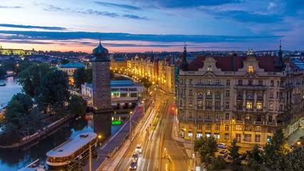 Sitkovska water-tower timelapse circa 1588 and traffic on road in old city center of Prague day to night. Fotomurales