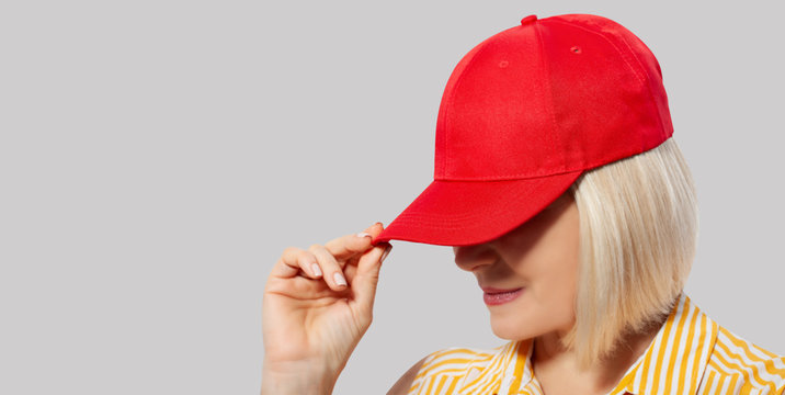 Blank red baseball cap mockup template, wear on women head, isolated, clipping path. Woman in clear hat and t shirt mock up holding visor of caps. Cotton basebal cap mokcup on delivery guy.