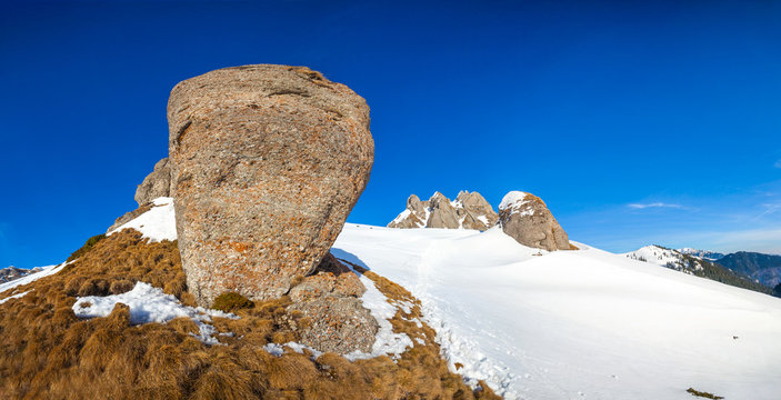 Panoramic view with rocks from Mount Ciucas peak on winter