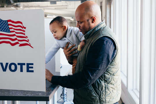 Father and son voting on election day