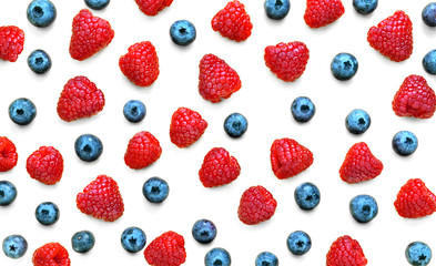 Colorful fruit pattern of raspberries and blueberries isolated on white background. Flat lay