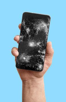 Broken phone in the hand isolate