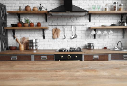 Empty wooden table in beautiful kitchen. Interior design