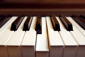 Detail of a piano keyboard with one key (b) pressed