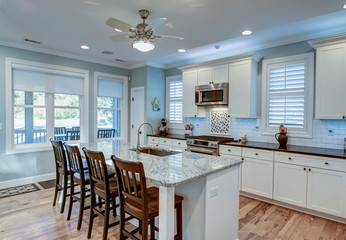 Beautiful luxury kitchen with quarz countertops and view windows