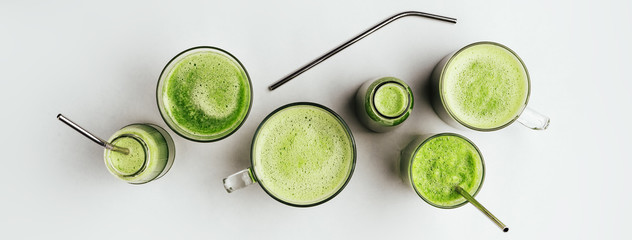 Cucumber vegan smoothie in many glasses, nutrient hydrating green juice, detox food, weight loss concept, white background, top view ,metal straw,zero waste,banner Papier Peint