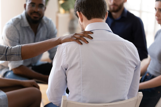 African upset guy and female psychologist during therapy