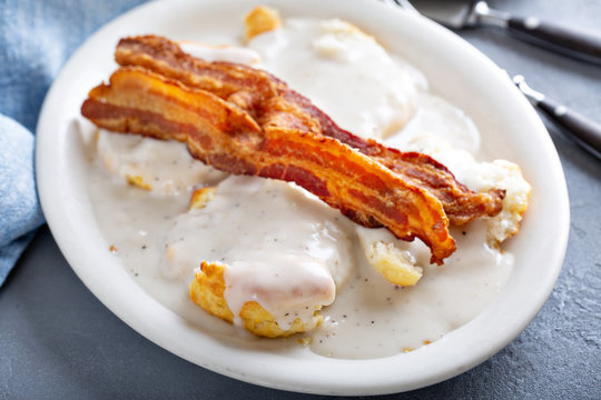 Biscuits and gravy with slices of bacon, southern breakfast