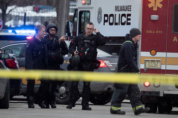 Police and emergency officials work at an active shooter scene at the Molson Coors headquarters in Milwaukee