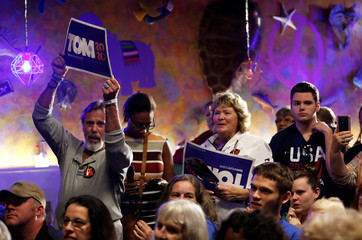 Supporters of Democratic 2020 U.S. presidential candidate Tom Steyer hold signs at a meet and greet at Nacho Hippo in Myrtle Beach