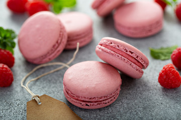 Canvas Prints Macarons Raspberry macarons on gray table with fresh raspberries and price tags