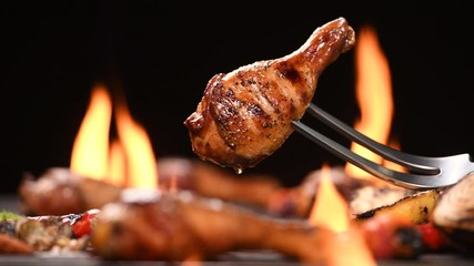 Wall Mural - Close up grill roast bbq chicken leg on the flaming grill , 4k