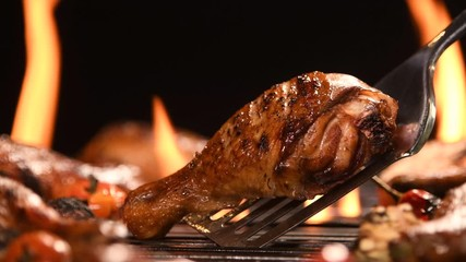 Fototapete - Close up grill roast bbq chicken leg on the flaming grill , 4k