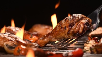 Fototapete - Close up grill roast bbq chicken leg on the flaming grill , HD slow motion