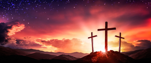 Spoed Fotobehang Ochtendgloren Three Wooden Crosses At Sunrise With Clouds And Starry Sky Background - Death And Resurrection Of Jesus Christ