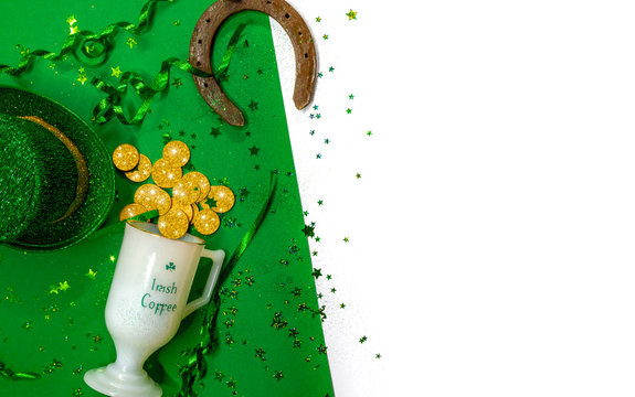 Saint Patricks day flat lay banner image with gold coins , leprechaun's hat, and other decorations