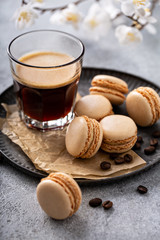 Coffee or chocolate macarons on a tray, trendy french dessert