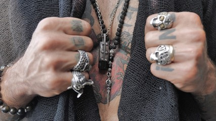 male hands open a heart-shaped tattoo on the chest