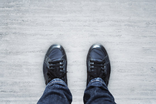 Top view of blue casual shoes on concrete floor background with copyspace