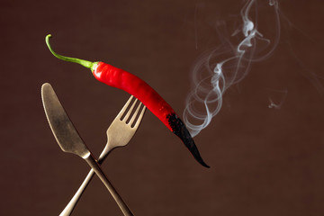 Canvas Prints Hot chili peppers Hot chili red pepper smoking on a fork. Spice concept.