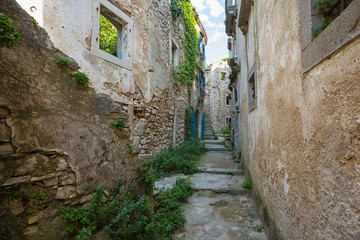 Wall Mural - old abandoned houses in ancient town of Plomin, Croatia.